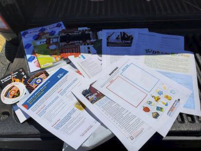 Pile of informational materials on a table