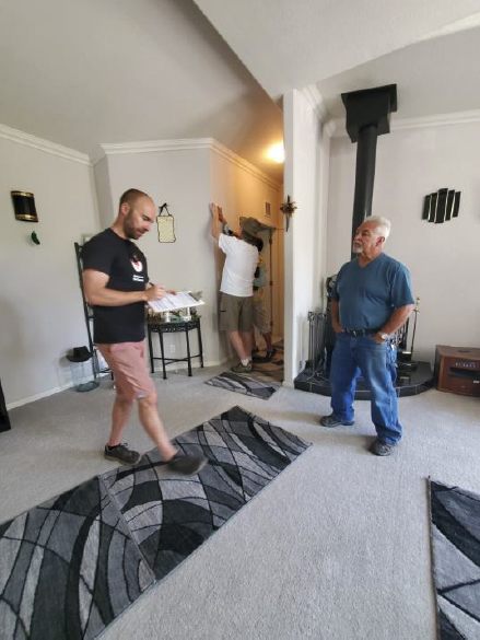 Two men standing inside a home
